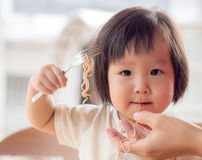 Happy Asian child eating Stock Photo