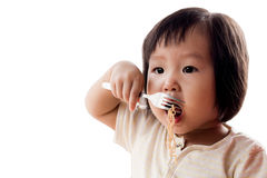 Happy Asian child eating Royalty Free Stock Photography