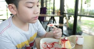 Happy asian child enjoy eating cake together stock video