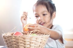 Happy asian child girl drawing and painting on easter egg. Prepare for easter day royalty free stock photos
