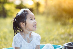 Happy asian child girl having fun to bath and play with foam. In outside Royalty Free Stock Image