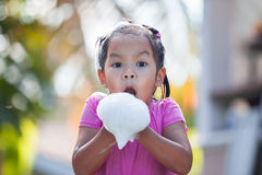 Happy asian child girl having fun to bath and play with foam. In outside Royalty Free Stock Photo