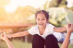 Asian child girl laughing and having fun to play with mother Royalty Free Stock Image
