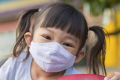 Free Happy Asian Child Girl Smiling And Wearing Fabric Mask Royalty Free Stock Images - 216331819