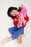 Happy asian child hand holding rose bouquet Stock Photography