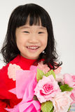 Happy asian child hand holding rose bouquet Royalty Free Stock Photos