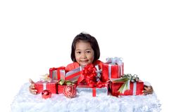 Happy asian child holding Christmas presents. Christmas or happy stock image