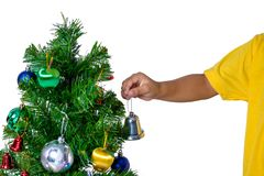 Happy asian child holding little bell for decoration Christmas t royalty free stock images