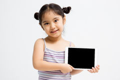 Happy Asian child holding tablet computer. On isolated background Stock Photography