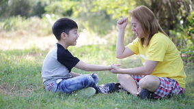 Happy asian child and mother playing in the park stock footage