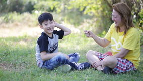 Happy asian child and mother playing in the park stock video footage