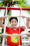 Happy asian child playing on playground Stock Photography