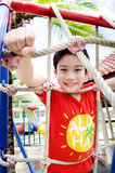 Happy asian child playing on playground Stock Image