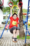Happy asian child playing on playground Royalty Free Stock Images