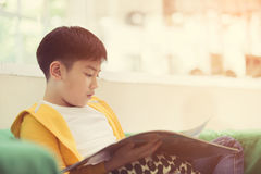 Happy asian child reading book with smile face. Stock Photography