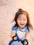 Happy Asian child on a seesaw Royalty Free Stock Photography
