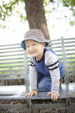 Happy asian child sitting on  the garden chair Stock Photo