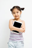 Happy Asian child with tablet computer Royalty Free Stock Photography