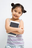 Happy Asian child with tablet computer. Happy Asian child with blank screen of tablet computer Royalty Free Stock Image