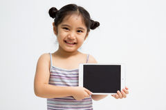 Happy Asian child with tablet computer Royalty Free Stock Photos