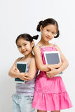 Happy Asian child with tablet computer Royalty Free Stock Image