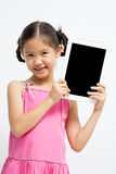 Happy Asian child with tablet computer. Happy Asian child with blank screen of tablet computer Stock Photography