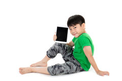Happy Asian child with tablet computer Stock Photography