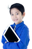 Happy Asian child with tablet computer on isolated background Royalty Free Stock Photo