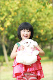 Happy asian child and teddy Royalty Free Stock Photos