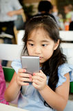 Happy Asian child  touching with smart phone Stock Image