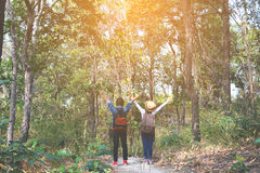 Happy Asian children backpack in nature background. Relax time on holiday concept travel , color of vintage tone and soft focus royalty free stock images