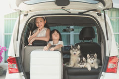 Happy asian children and siberian husky puppy sitting Royalty Free Stock Images
