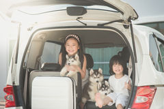 Happy asian children and siberian husky puppy sitting Royalty Free Stock Photo