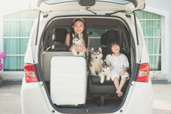 Happy asian children and siberian husky puppy sitting Royalty Free Stock Photography