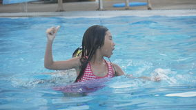 Happy Asian children swimming at pool stock video footage