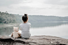 Happy asian children with teddy bear in nature ,relax time on holiday. Vintage tone and soft focus royalty free stock photo