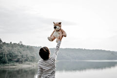 Happy asian children with teddy bear in nature ,relax time on holiday. Vintage tone and soft focus royalty free stock photography