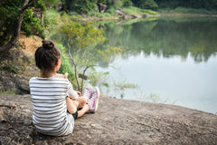 Happy asian children with teddy bear in nature ,relax time on holiday Royalty Free Stock Images