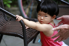 Happy Asian Chinese baby girl play in a garden Royalty Free Stock Photography
