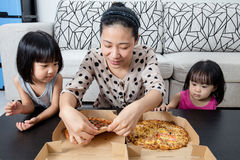 Happy Asian Chinese Family Enjoying Pizza Together Royalty Free Stock Images