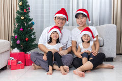 Happy Asian Chinese family sitting on the floor celebrating Chri Royalty Free Stock Image