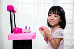 Happy Asian Chinese Liitle Girl Playing Make-Up Toys Stock Image