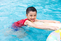 Happy Asian Chinese Little Boy Swimming With Floating Board. At Outdoor Swimming Pool royalty free stock photos