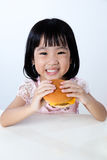 Happy Asian Chinese little girl Eating Burger Stock Photos