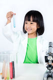 Happy Asian Chinese Little Girl Examining Test Tube With Uniform Royalty Free Stock Photos