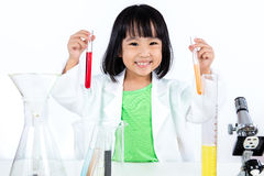 Happy Asian Chinese Little Girl Examining Test Tube With Uniform Stock Images