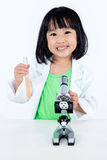 Happy Asian Chinese Little Girl Examining Test Tube With Uniform Royalty Free Stock Image