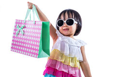 Happy Asian Chinese Little Girl Holding Shopping Bags Royalty Free Stock Photos
