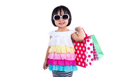Happy Asian Chinese Little Girl Holding Shopping Bags Royalty Free Stock Images