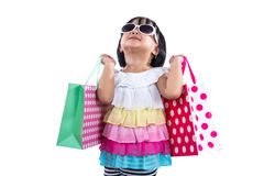 Happy Asian Chinese Little Girl Holding Shopping Bags Royalty Free Stock Photo